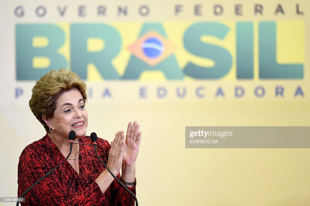 TOPSHOT - Brazilian President Dilma Rousseff during a ceremony to announce the creation of new public universities, at Planalto Palace in Brasilia, on May 9, 2016. The impeachment of Brazilian President Dilma Rousseff was thrown into confusion when Waldir Maranhao, the interim speaker of the lower house of Congress annulled on May 9, 2016 an April vote by lawmakers to launch the process. He wrote in an order that a new vote should take place on whether to impeach Rousseff. / AFP / EVARISTO SA