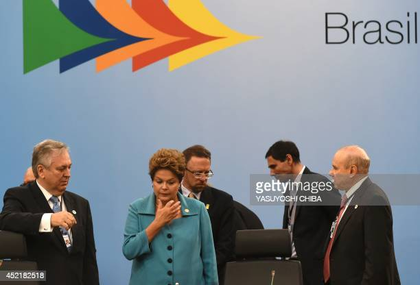 Brazilian President Dilma Rousseff her Foreign Minister Luiz Alberto Figueiredo and her Economy Minister Guido Mantega speak before the 6th BRICS...