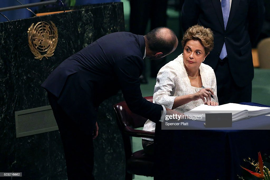 Brazilian President Dilma Rousseff signs the accord at the United Nations Signing Ceremony for the Paris Agreement climate change accord that came out of negotiations at the COP21 climate summit last December in Paris. on April 22, 2016 in New York City. At least 155 countries are expected to sign the agreement which has the goal of limiting warming to 'well below' 2 degrees Celsius above preindustrial levels. The ceremony symbolically takes place on Earth Day.