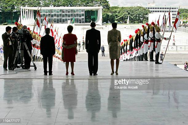 Brazilian President Dilma Rousseff US President Barack Obama and first lady Michelle Obama during the National Anthem at Palacio do Planalto on March...