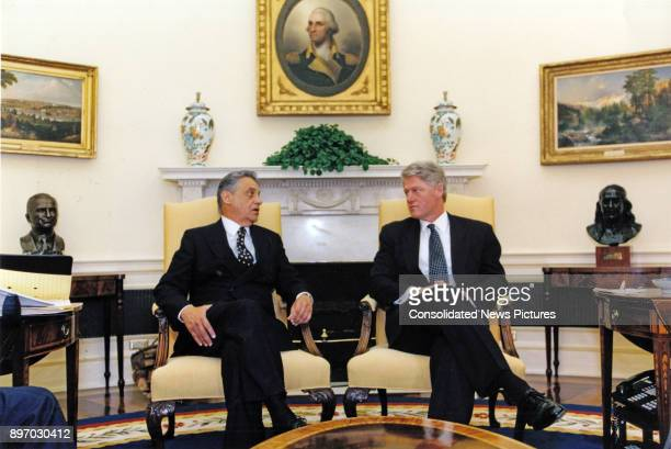 Brazilian President Fernando Henrique Cardoso and US President Bill Clinton talk together in the White House's Oval Office Washington DC April 20 1995