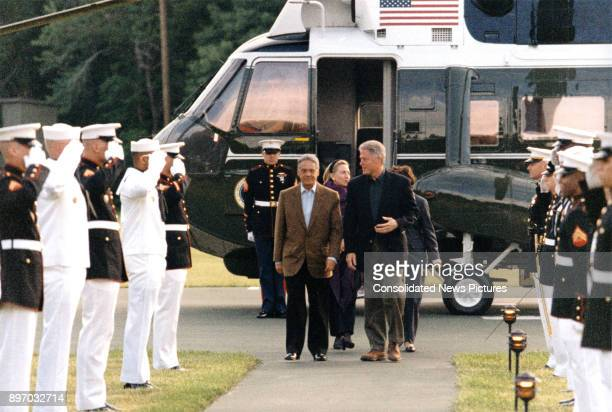 Brazilian President Fernando Henrique Cardoso is escorted by US President Bill Clinton as they arrive at Camp David near Thurmont Maryland June 7...