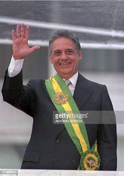 Brazilian President Fernando Henrique Cardoso waves from the Planalto Palace in Brasilia after receiving the presidential sash from his predecessor...