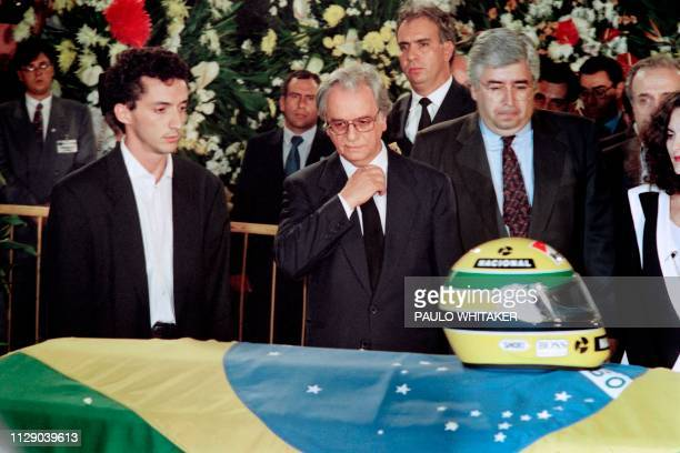 Brazilian President Itamar Franco pays his respects to Formula One triple world champion Ayrton Senna on May 4 accompanied by Senna's brother...