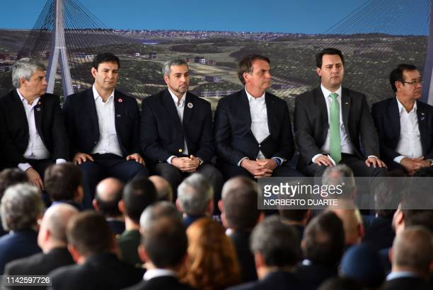 Brazilian President Jair Bolsonaro and his Paraguayan counterpart Mario Abdo Benitez take part in a ceremony to launch the foundation stone of a...