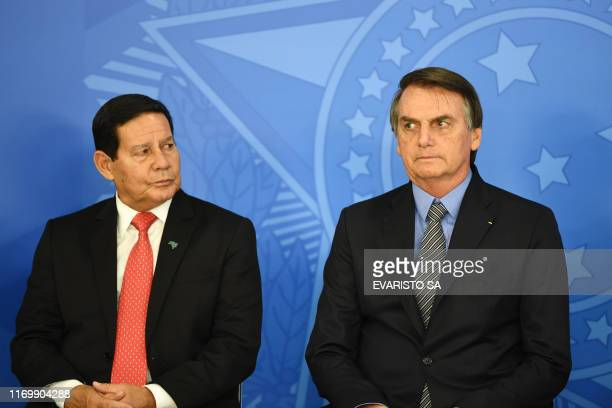 Brazilian President Jair Bolsonaro and his vicepresident Hamilton Mourao attend a ceremony to pass the Economic Freedom Act at Planalto Palace in...