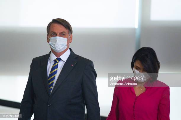 Brazilian President Jair Bolsonaro and his wife arrive forthe launch of the Rural Women Campaign amidstthe coronavirus pandemic at the Palacio do...