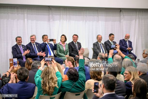 Brazilian President Jair Bolsonaro and wife Michelle Bolsonaro alongside cabinet members attend an event with Miami's Brazilian community at Miami...