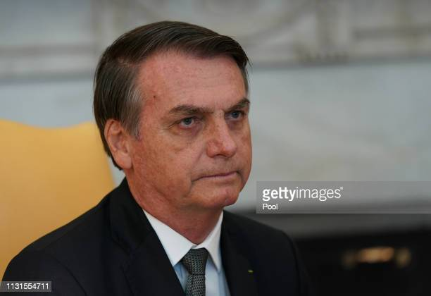 Brazilian President Jair Bolsonaro attends a meeting with US President Donald Trump at the White House March 19 2019 in Washington DC President Trump...