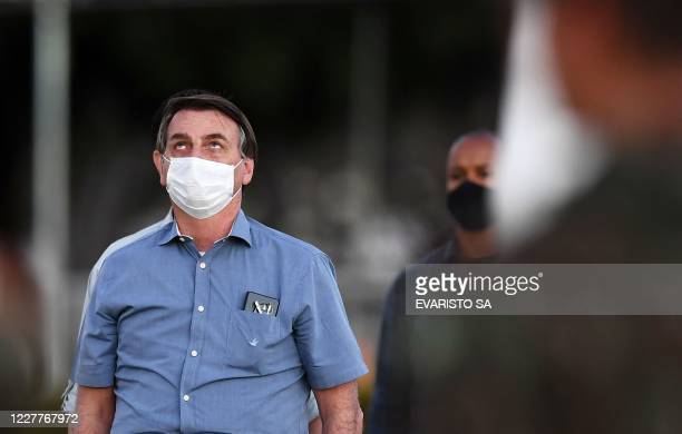 TOPSHOT Brazilian President Jair Bolsonaro attends the flag unveiling ceremony in the garden of the Alvorada Palace in Brasilia on July 24 2020