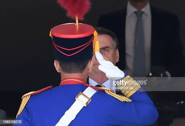 Brazilian President Jair Bolsonaro attends the guard change ceremony at Planalto Palace in Brasilia on January 15 2019