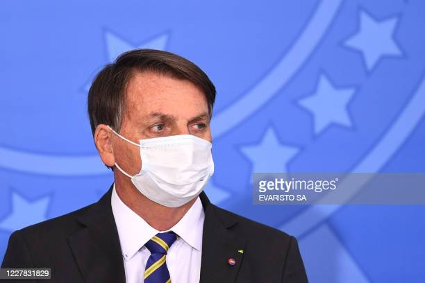 Brazilian President Jair Bolsonaro attends the launch of the Rural Women's Rights program at Planalto Palace in Brasilia on July 29 2020 This is the...