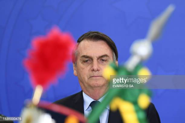 TOPSHOT Brazilian President Jair Bolsonaro attends the new general officers' promotion ceremony at the Planalto Palace in Brasilia on April 5 2019...