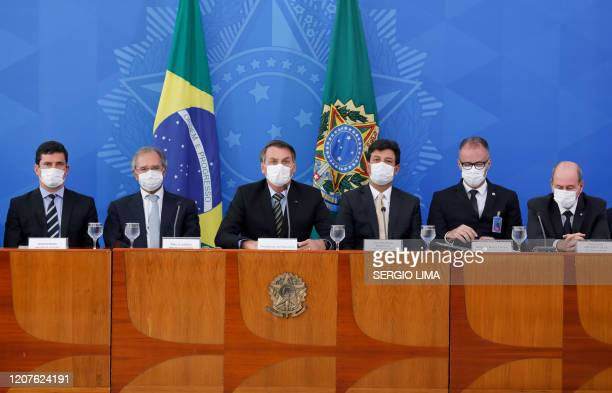 Brazilian President Jair Bolsonaro delivers a press conference related to the new coronavirus COVID19 accompanied by his cabinet at the Planalto...