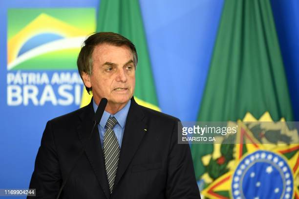 Brazilian President Jair Bolsonaro delivers a speech during a ceremony to pass the Economic Freedom Act at Planalto Palace in Brasilia on September...
