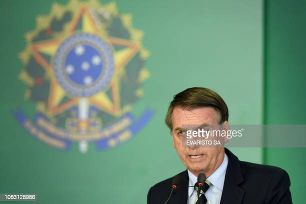 Brazilian President Jair Bolsonaro delivers a speech during the signing ceremony of the presidential decree that flexibilizes the possession of...