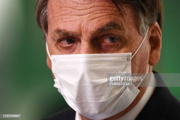 Brazilian President Jair Bolsonaro delivers a statement to members of the media on the resumption of emergency aid payments to the population most...