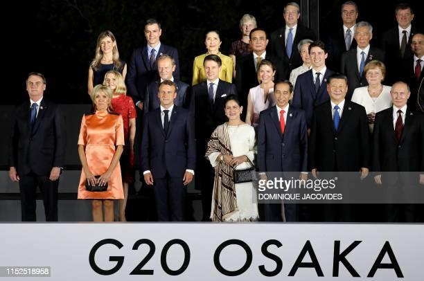 Brazilian President Jair Bolsonaro, French President's wife Brigitte Macron and French President Emmanuel Macron, Indonesia President Joko Widodo and...