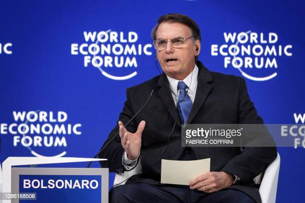 Brazilian President Jair Bolsonaro gestures as he delivers a speech during the World Economic Forum annual meeting on January 22 2019 in Davos...