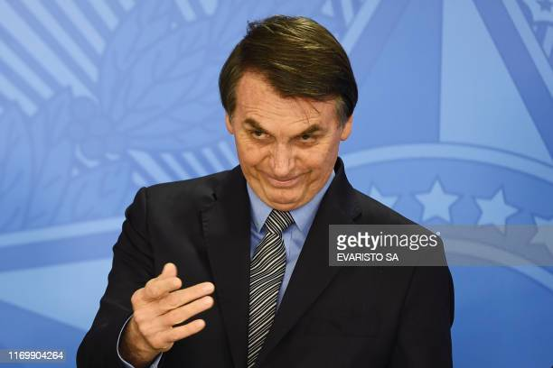 Brazilian President Jair Bolsonaro gestures during a ceremony to pass the Economic Freedom Act at Planalto Palace in Brasilia on September 20 2019 At...