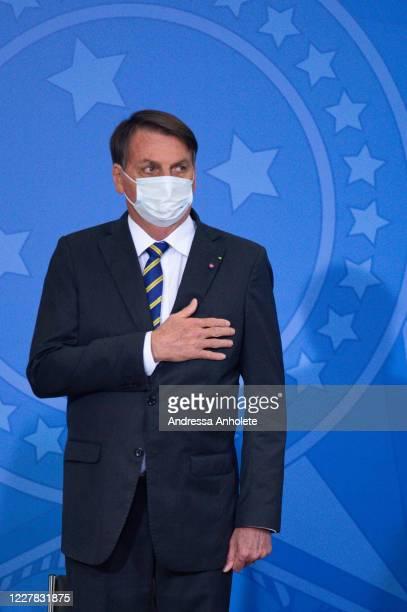 Brazilian President Jair Bolsonaro gestures during launch of the Rural Women Campaign amidstthe coronavirus pandemic at the Palacio do Planalto on...