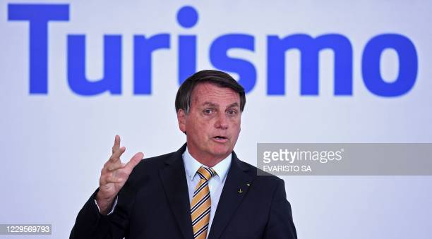 Brazilian President Jair Bolsonaro gestures during the launch of a program for the resumption of tourism, a sector severely affected by the new...