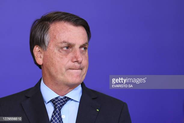 Brazilian President Jair Bolsonaro gestures during the launch of the Alliance for Volunteering aid program at Planalto Palace in Brasilia, on...