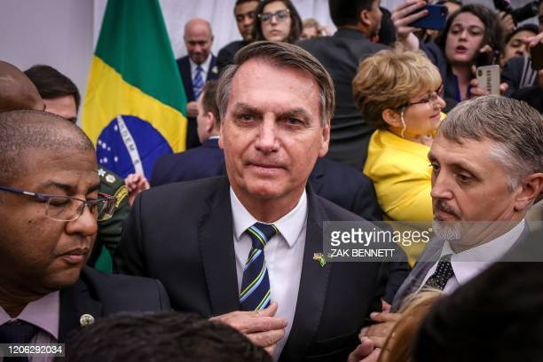 Brazilian President Jair Bolsonaro greets Miami's Brazilian community after an event at Miami Dade College's Medical Campus in Miami Florida on March...