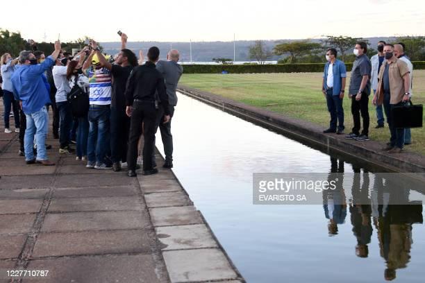 TOPSHOT Brazilian President Jair Bolsonaro greets supporters at Alvorada Palace in Brasilia on July 20 2020