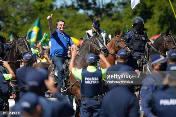 Brazilian President Jair Bolsonaro horseriding during a demonstration in favor of his government amidst the coronavirus pandemic in front of Planalto...