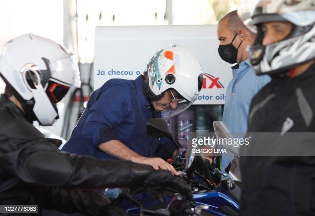 Brazilian President Jair Bolsonaro is pictured after going out for a ride and having his motorcycle's engine overhaul after he announced he tested...