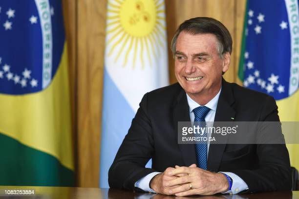 Brazilian President Jair Bolsonaro is pictured during the signing of an agreement with Argentina's President Mauricio Macri at Planalto Palace in...