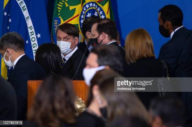 Brazilian President Jair Bolsonaro looks on after launching the Rural Women Campaign amidstthe coronavirus pandemic at the Palacio do Planalto on...
