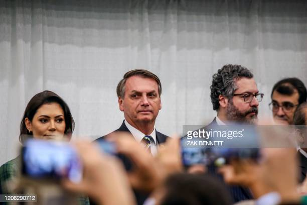 Brazilian President Jair Bolsonaro looks on during the Brazilian national anthem in front of Miami's Brazilian community at Miami Dade College's...