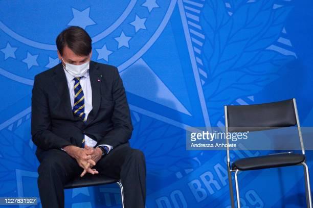 Brazilian President Jair Bolsonaro reacts during launch of the Rural Women Campaign amidstthe coronavirus pandemic at the Palacio do Planalto on...