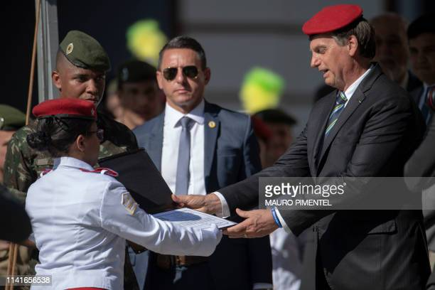 Brazilian President Jair Bolsonaro receives an honorary title from the Rio de Janeiro Military School during the celebration of the 130th anniversary...