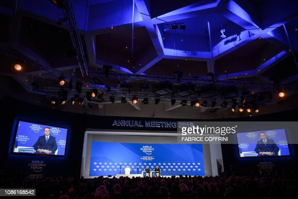 Brazilian President Jair Bolsonaro sits on stage next to founder and Executive Chairman of the World Economic Forum Klaus Schwab during the World...
