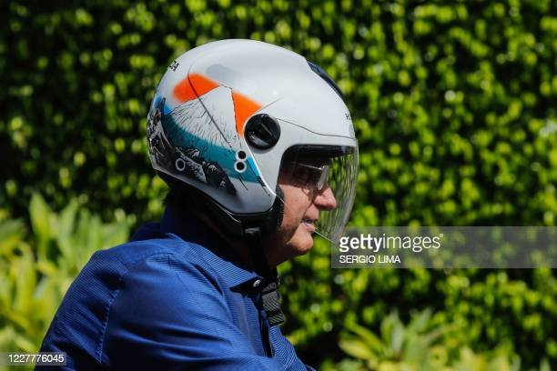Brazilian President Jair Bolsonaro takes a ride and has his motorcycle's engine overhaul after he announced he tested negative for COVID19 more than...