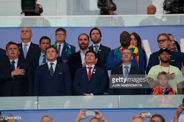 Brazilian President Jair Bolsonaro the president of the South American football's governing body Conmebol Paraguayan Alejandro Dominguez the...