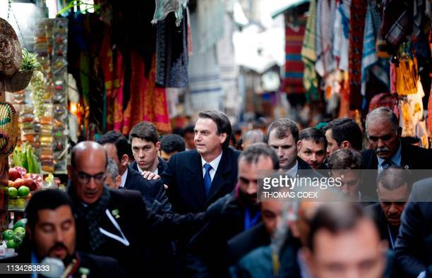 Brazilian President Jair Bolsonaro walks in the streets of Jerusalem's Old City after a visit to the Church of the Holy Sepulchre on April 1 2019