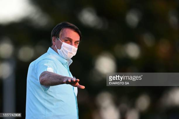 TOPSHOT Brazilian President Jair Bolsonaro walks towards supporters in the garden of the Alvorada Palace in Brasilia on July 22 2020 Bolsonaro tested...