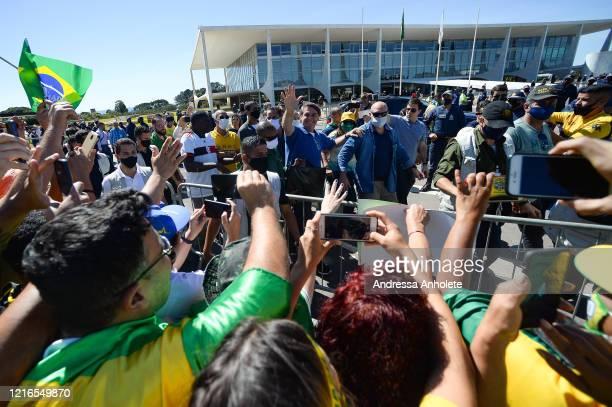 Brazilian President Jair Bolsonaro waves duringa demonstrationin favor of his governmentamidstthe coronavirus pandemic in front of Planalto...