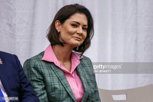 Brazilian President Jair Bolsonaro' wife Michelle Bolsonaro looks on during an event with Miami's Brazilian community at Miami Dade College's Medical...