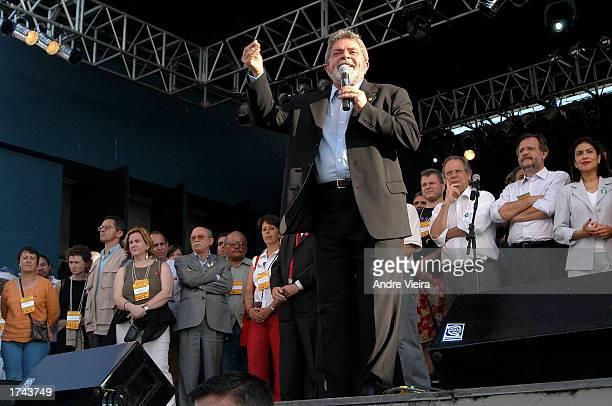 Brazilian President Luis Inacio Lula da Silva makes a speech at the World Social Forum January 24 2003 in Porto Alegre Brazil as members of his...