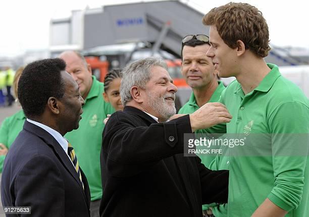 Brazilian President Luiz Inacio Lula da Silva and Brazilian former footballer Pele greet Brazilian swimmer and Olympic gold medallist Cesar Cielo on...