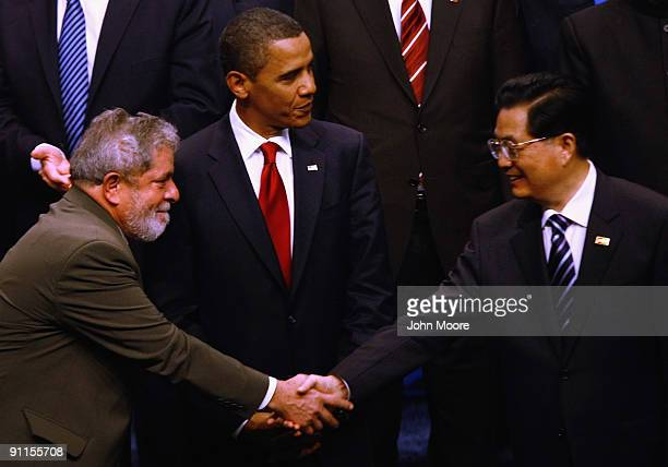 Brazilian President Luiz Inacio Lula da Silva and Chinese President Hu Jintao shake hands after posing with fellow world leaders for the offical...