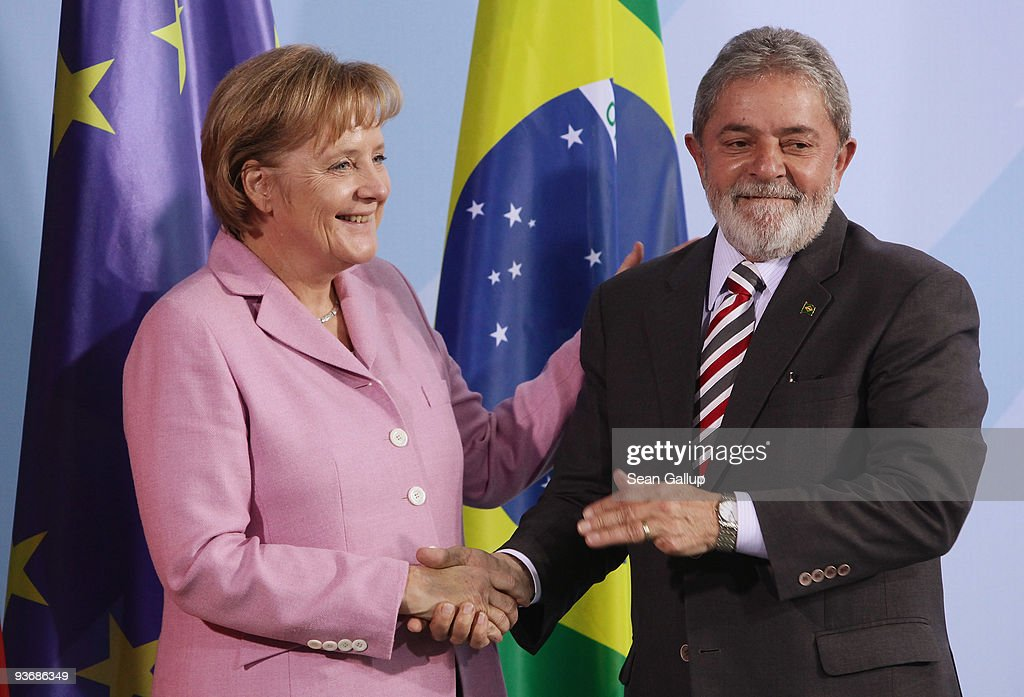 Brazilian President Luiz Inacio Lula da Silva and German Chancellor Angela Merkel shake hands after speaking to the media following talks on December 3, 2009 in Berlin, Germany. Ministers from the two countries signed a series of documents on mutual cooperation, including one aimed at supporting measures to reduce global warming.