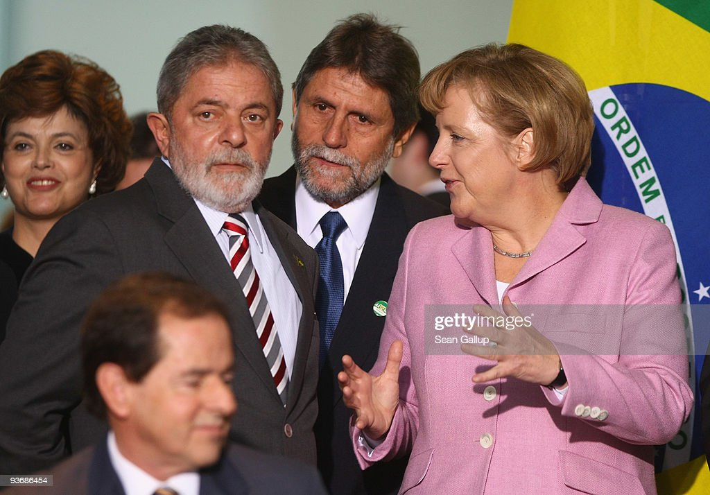 Brazilian President Luiz Inacio Lula da Silva and German Chancellor Angela Merkel chat during the signing of several documents following talks on December 3, 2009 in Berlin, Germany. Ministers from the two countries signed a series of documents on mutual cooperation, including one aimed at supporting measures to reduce global warming.
