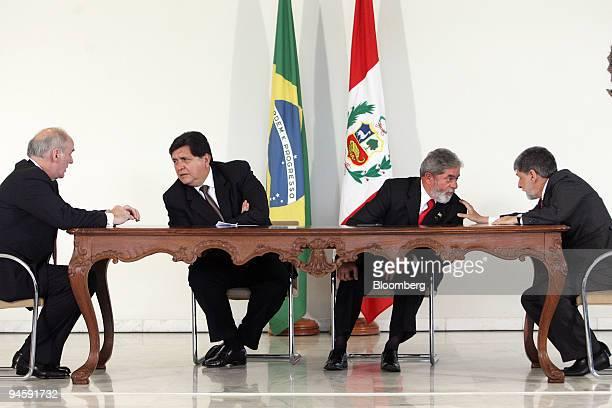 Brazilian President Luiz Inacio Lula da Silva, center right, speaks to Peruvian Foreign Minister Jose Antonio Garcia Belaunde and Peruvian President...