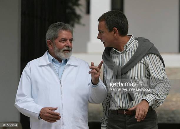 Brazilian President Luiz Inacio Lula da Silva chats with Spanish Prime Minister Jose luis Rodriguez Zapatero at the Quintos de Mora ranch near Toledo...